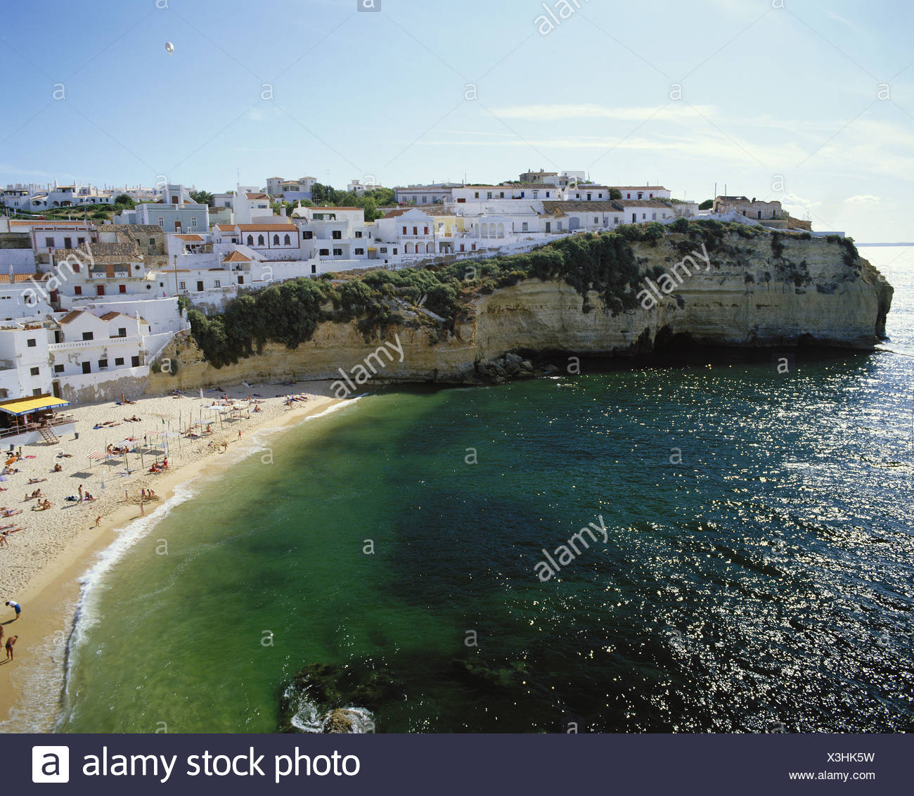 Algarve Carvoeiro cliff coast houses homes Portugal beach seashore - Stock Image