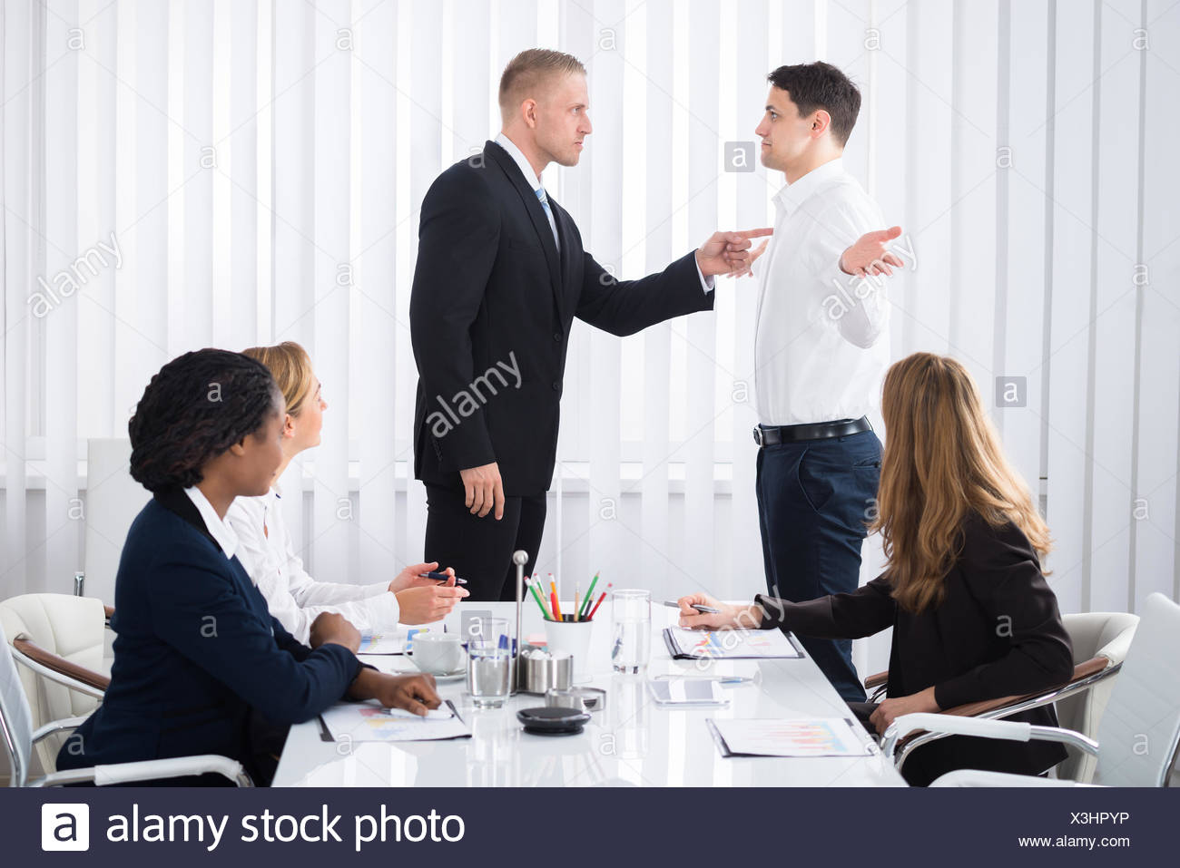 Businessman Blaming His Colleague In Meeting - Stock Image