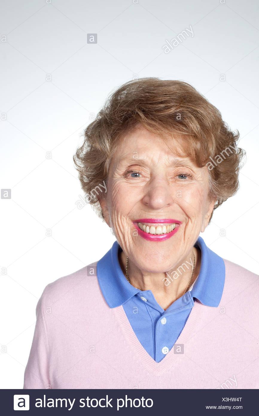 Senior woman looking at camera, studio shot Stock Photo