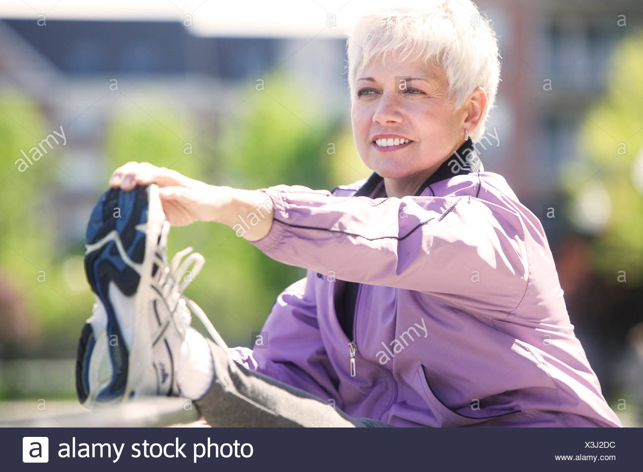 Mature woman working out outdoors - Stock Image
