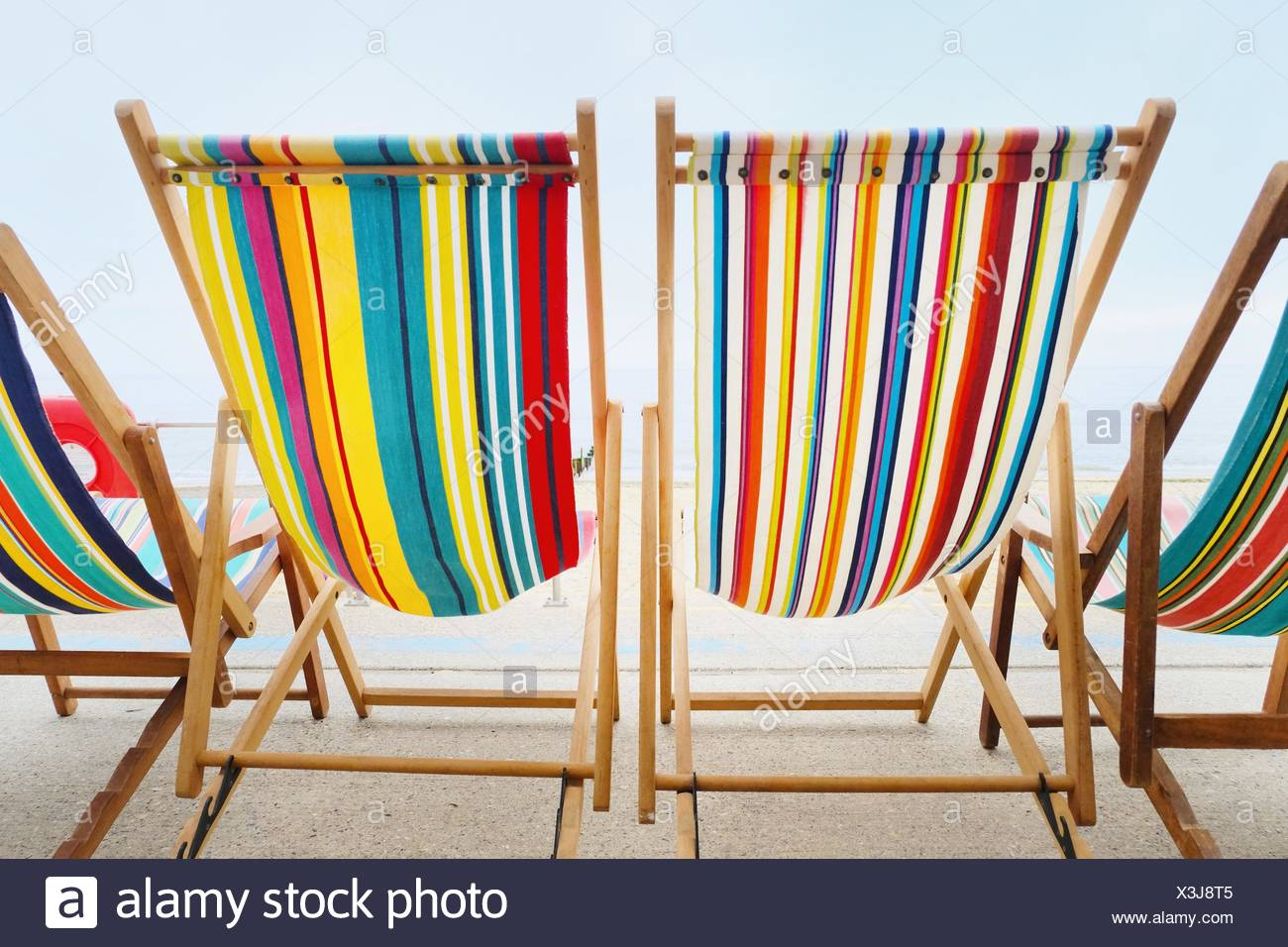 Empty deckchairs in a row - Stock Image