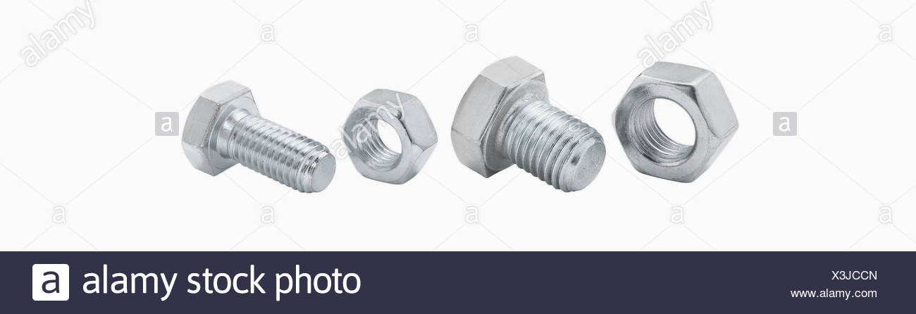 Bolts and nuts against white background, close up Stock Photo