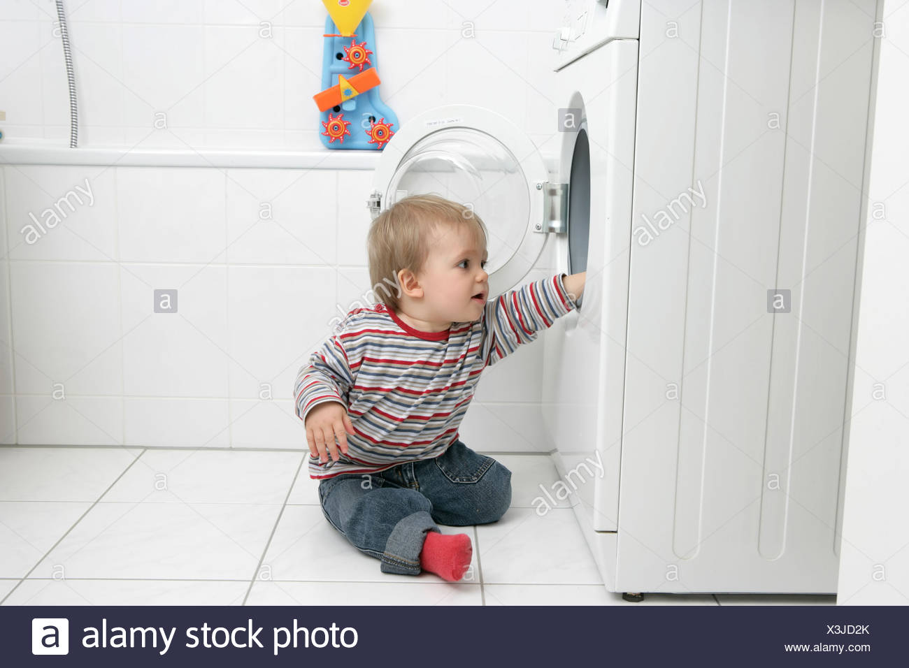 why is my daughter sitting on the washing machine