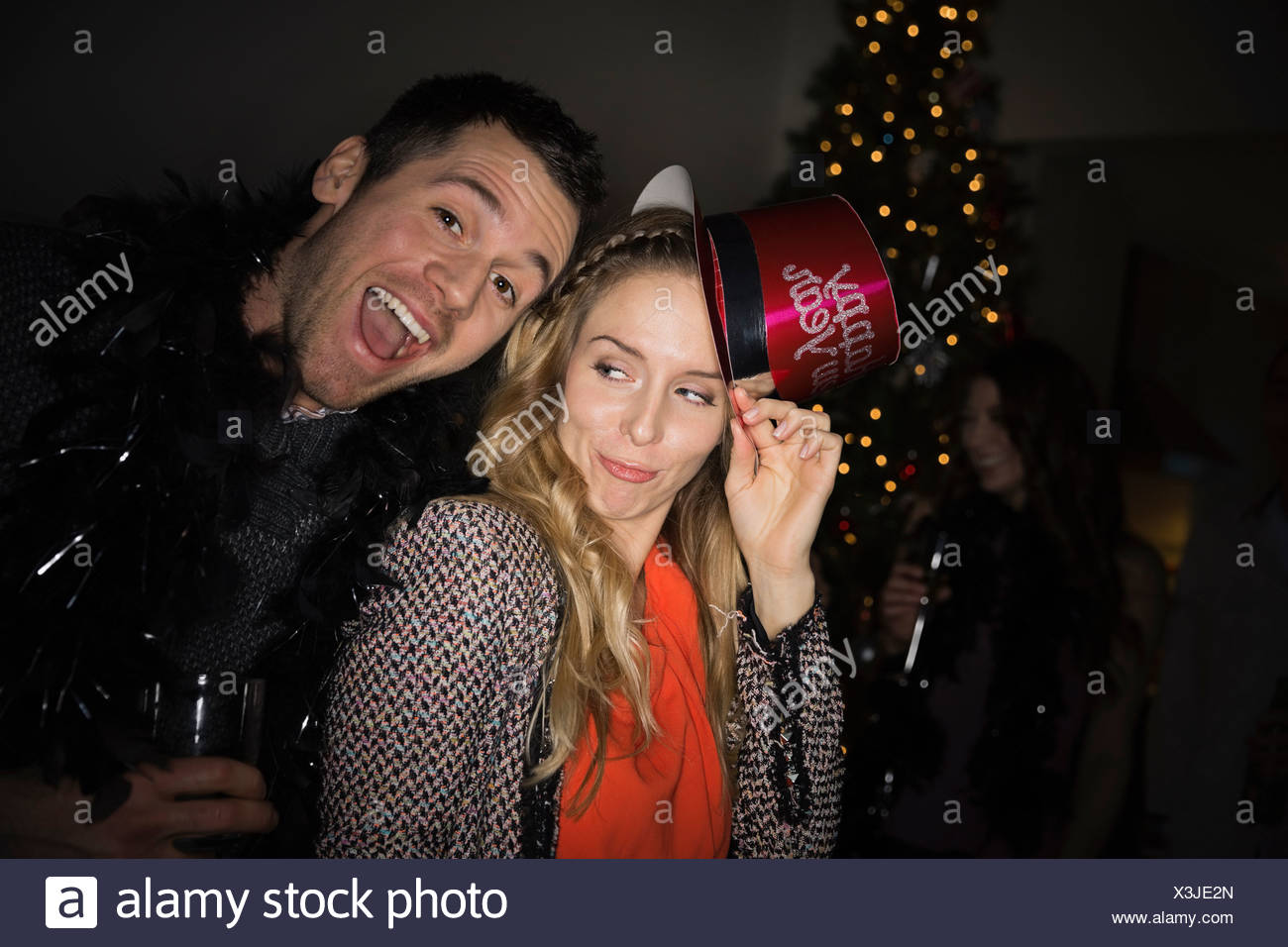 Couple enjoying New Years Eve party - Stock Image