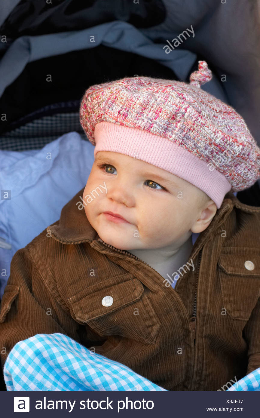 Close-up of an adorable baby girl in jacket and beret looking up ... 06da6a88cda