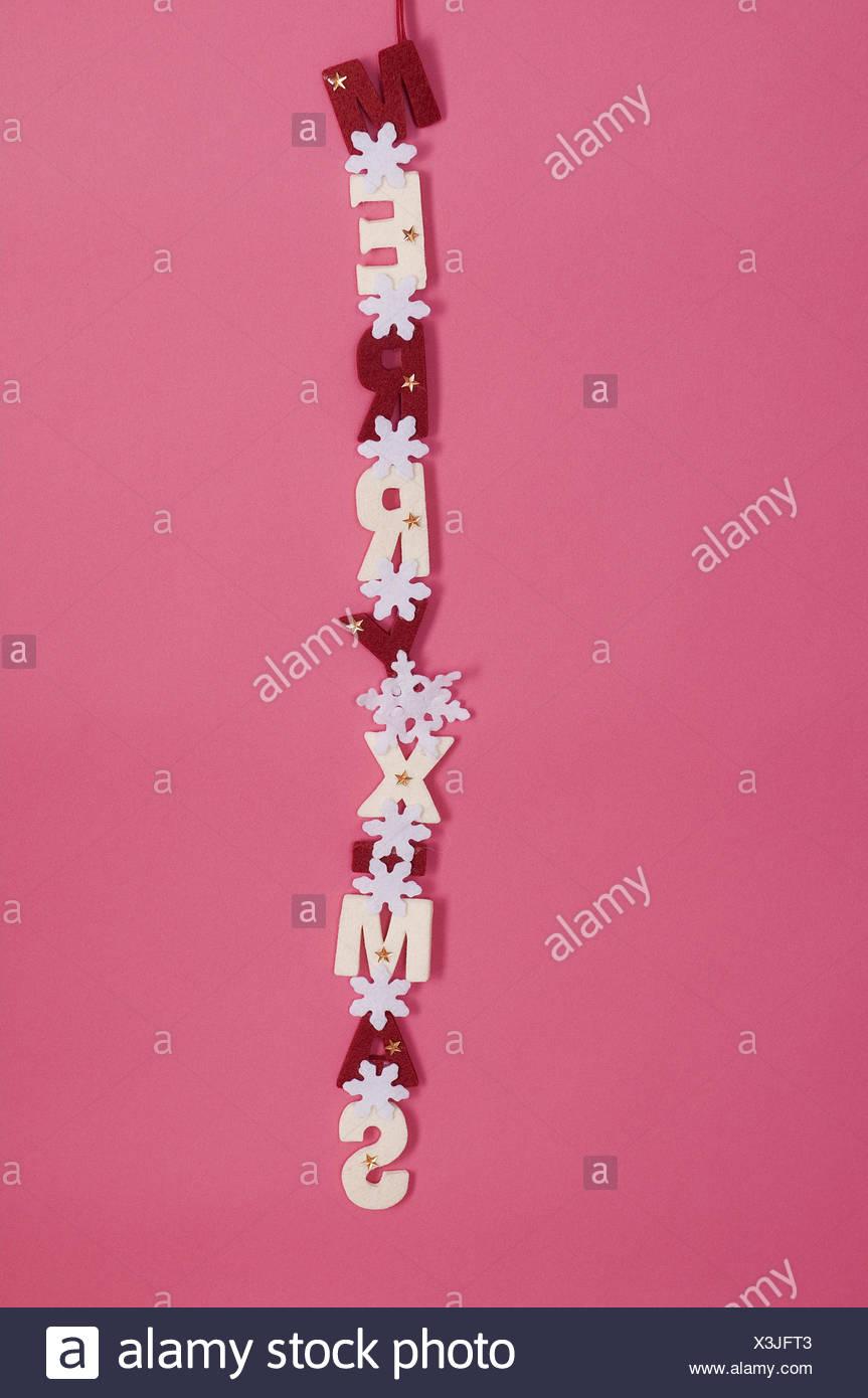 Garland 'Merry X Mas', - Stock Image