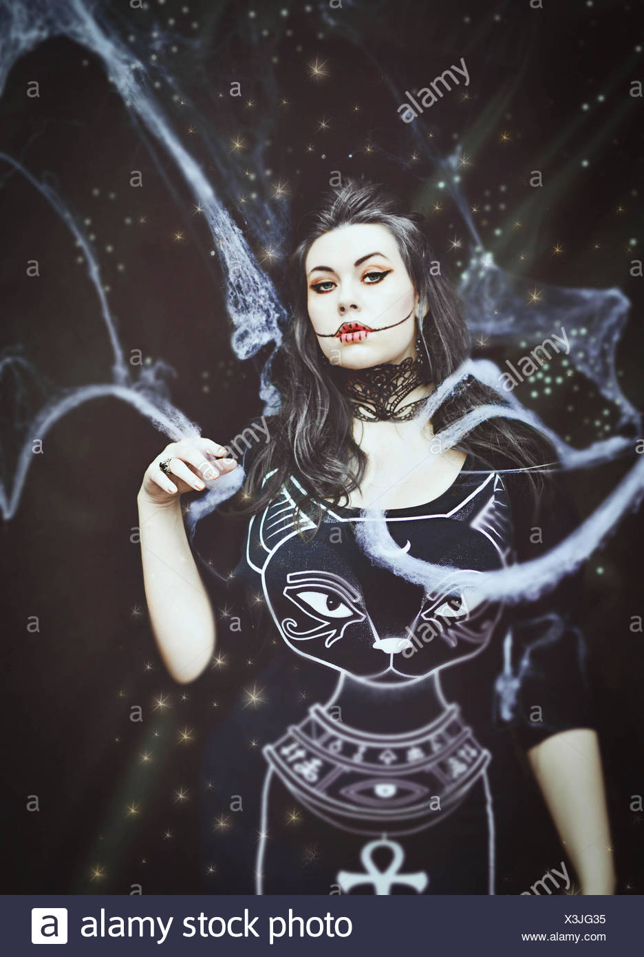 Witch halloween studio portrait - Stock Image