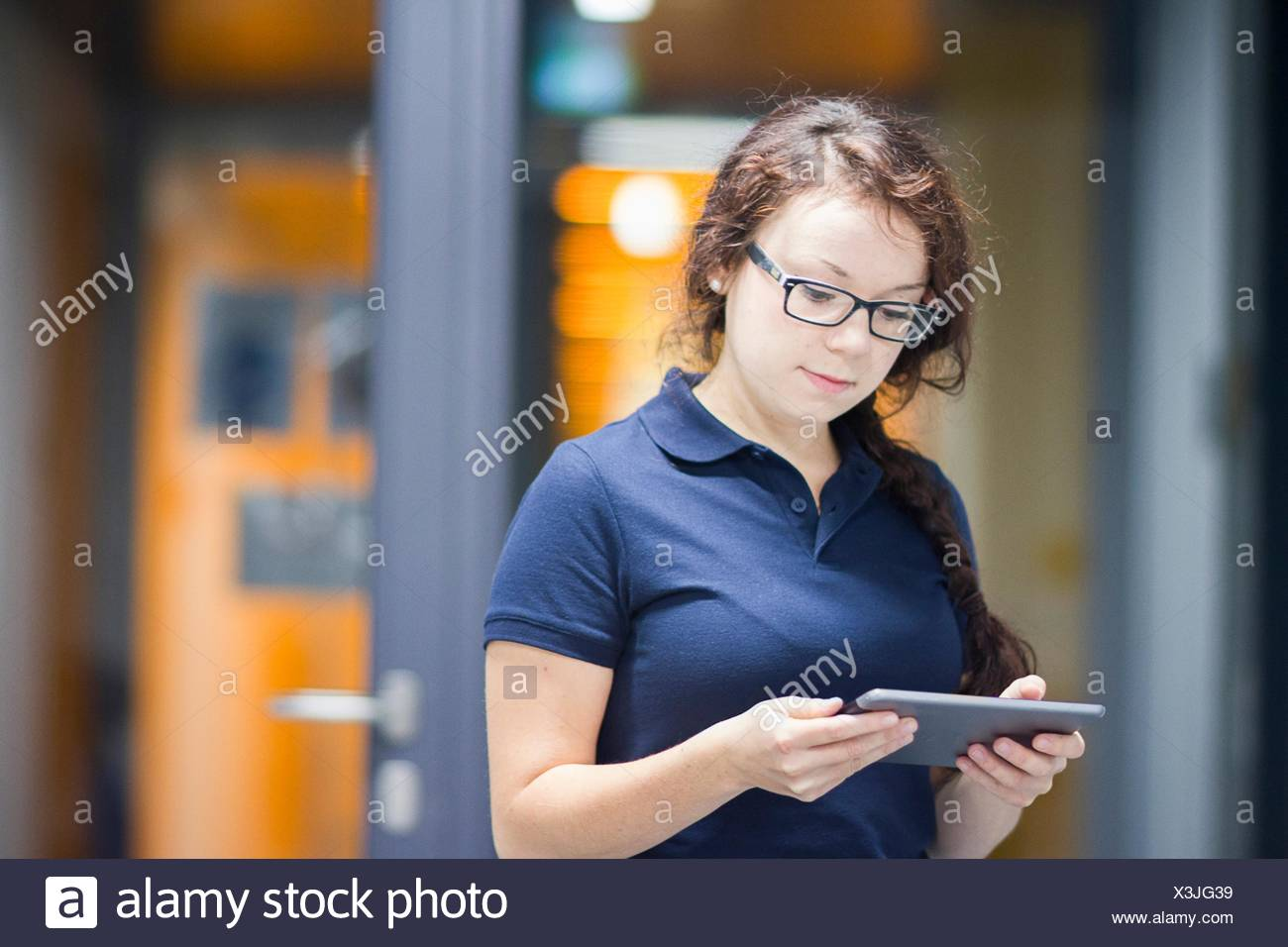 Technician using digital tablet in laboratory - Stock Image
