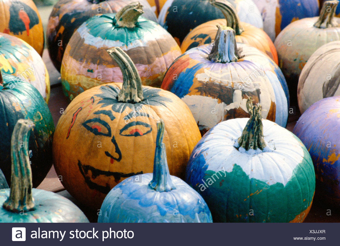 Pumpkins with painted faces for Halloween - Stock Image