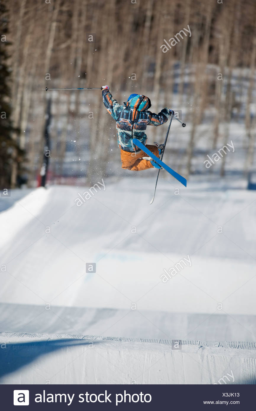 A downhill skier jumping - Stock Image
