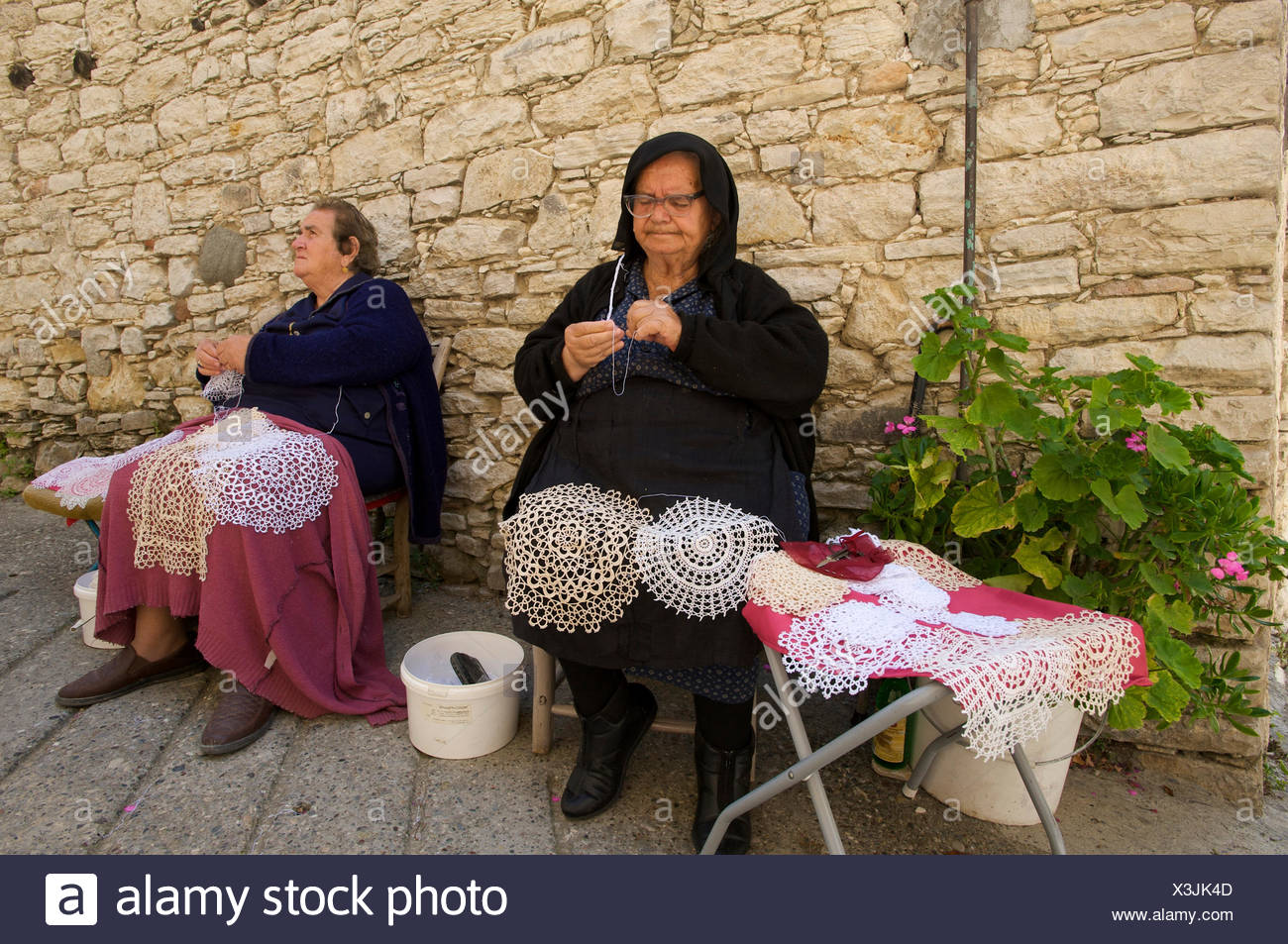 Women doing traditional crochet work in Omodos, Troodos Mountains, southern Cyprus - Stock Image