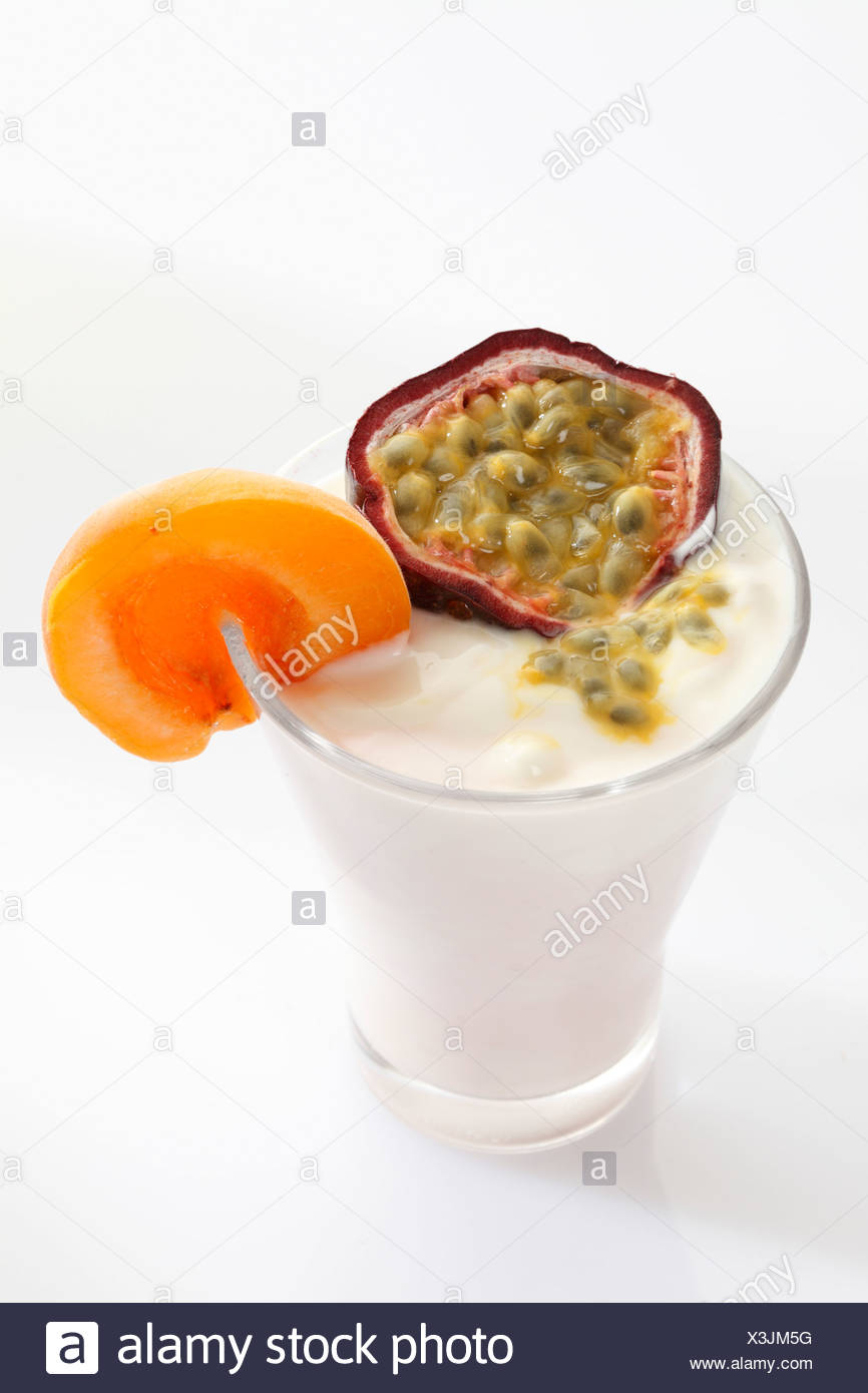 A glass of yogurt with apricot and a passionfruit - Stock Image