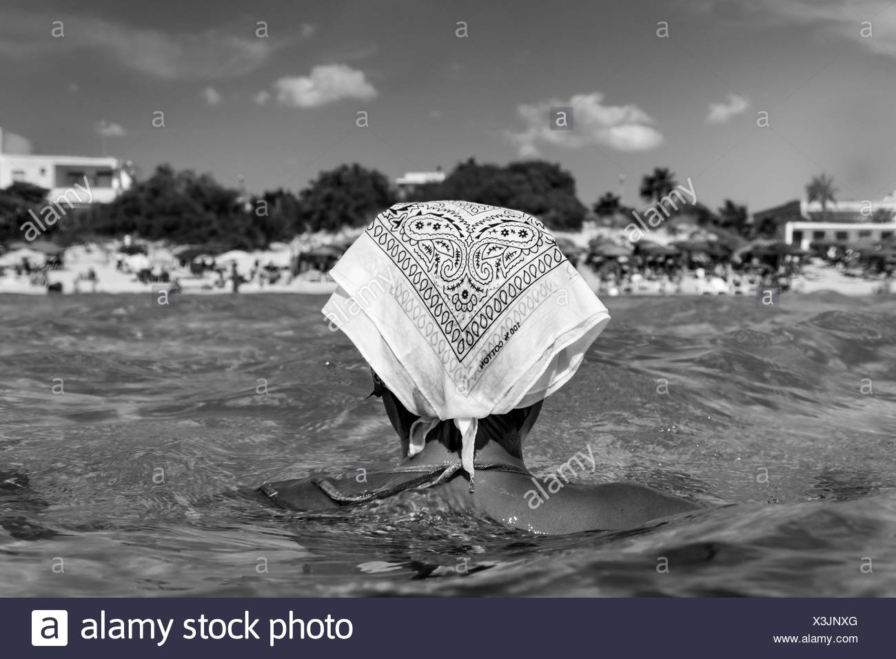 Rea View Of Woman Swimming In Lake Against Sky - Stock Image