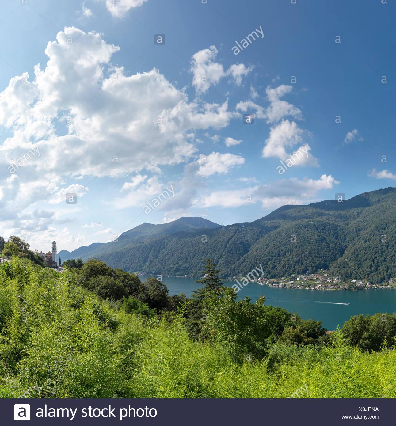 Switzerland, Europe, Vico Morcote, Ticino, banks, Lake Lugano, landscape, water, trees, summer, mountains, lake, clouds, - Stock Image