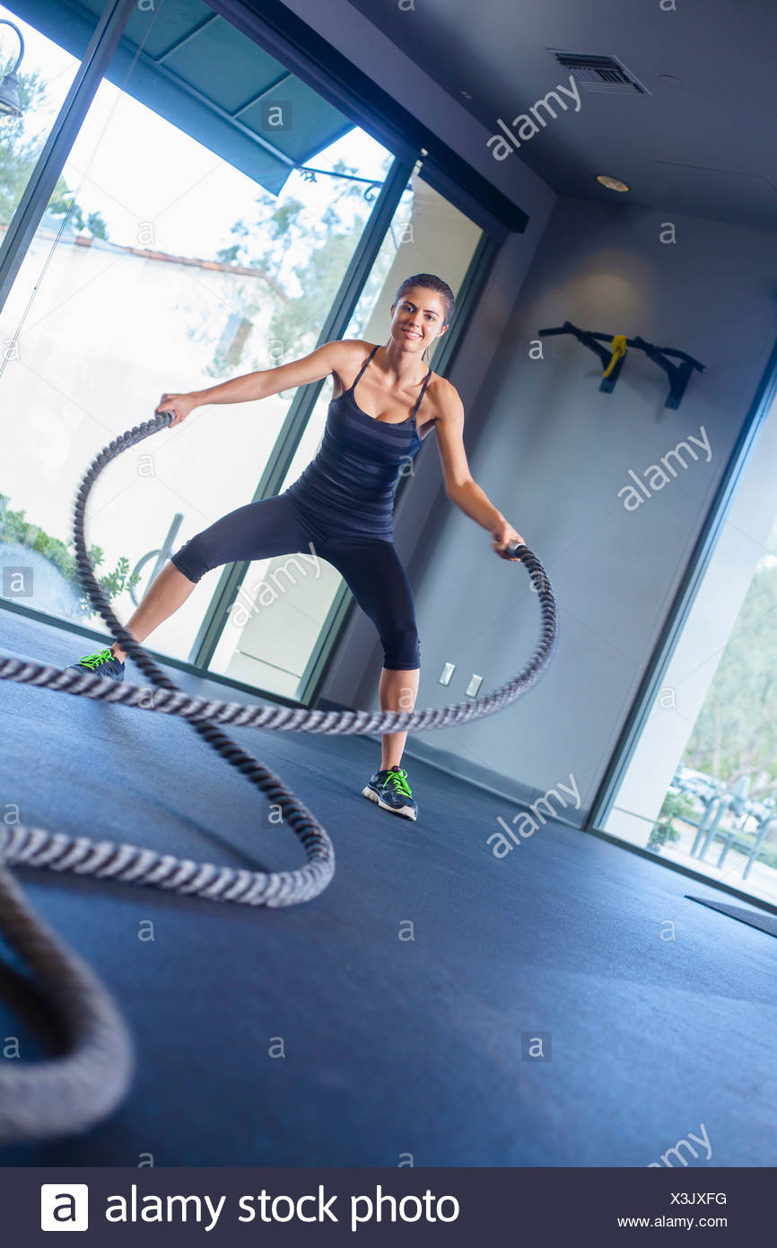 Young woman working out with rope - Stock Image