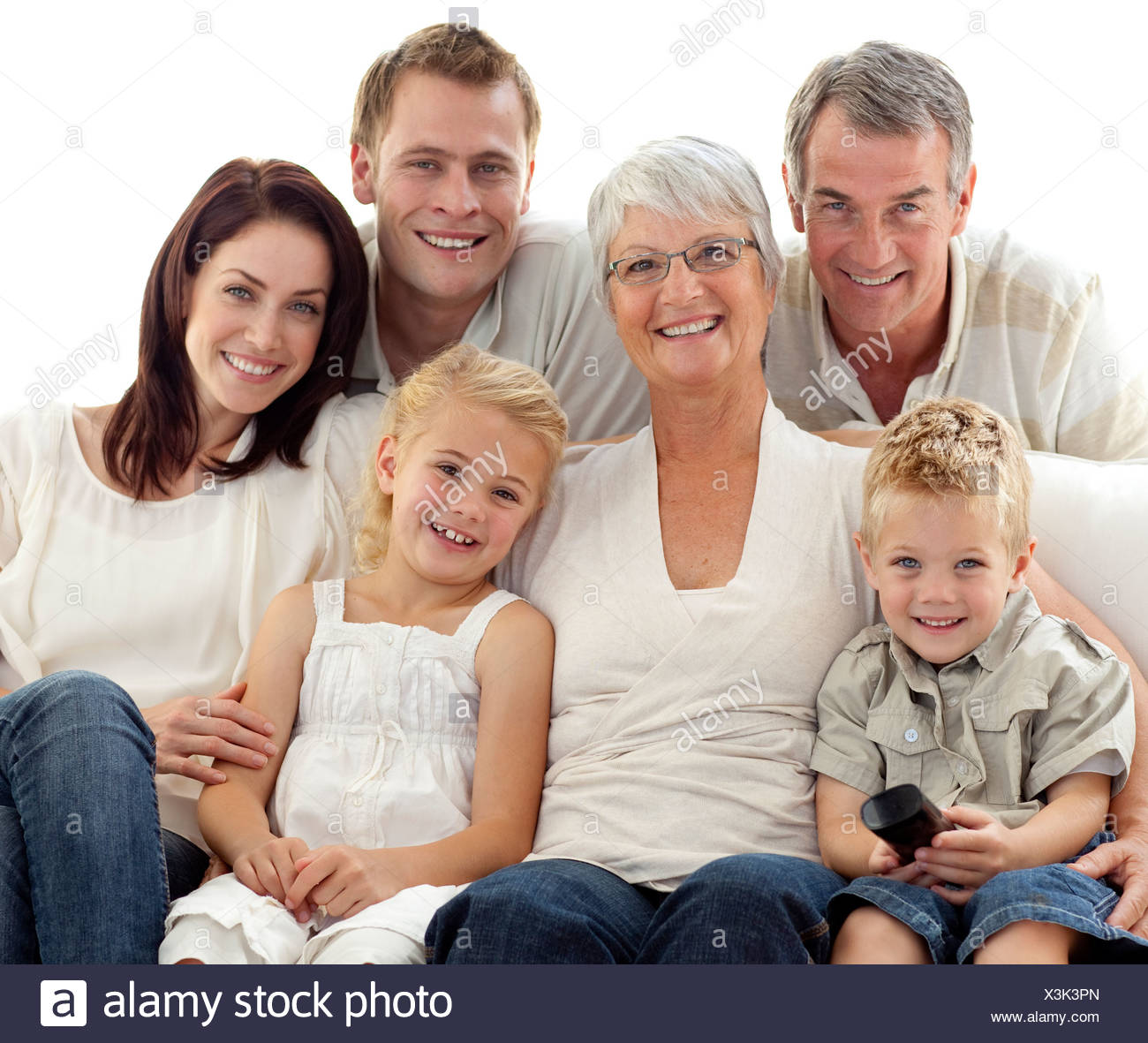 Family watching television at home - Stock Image