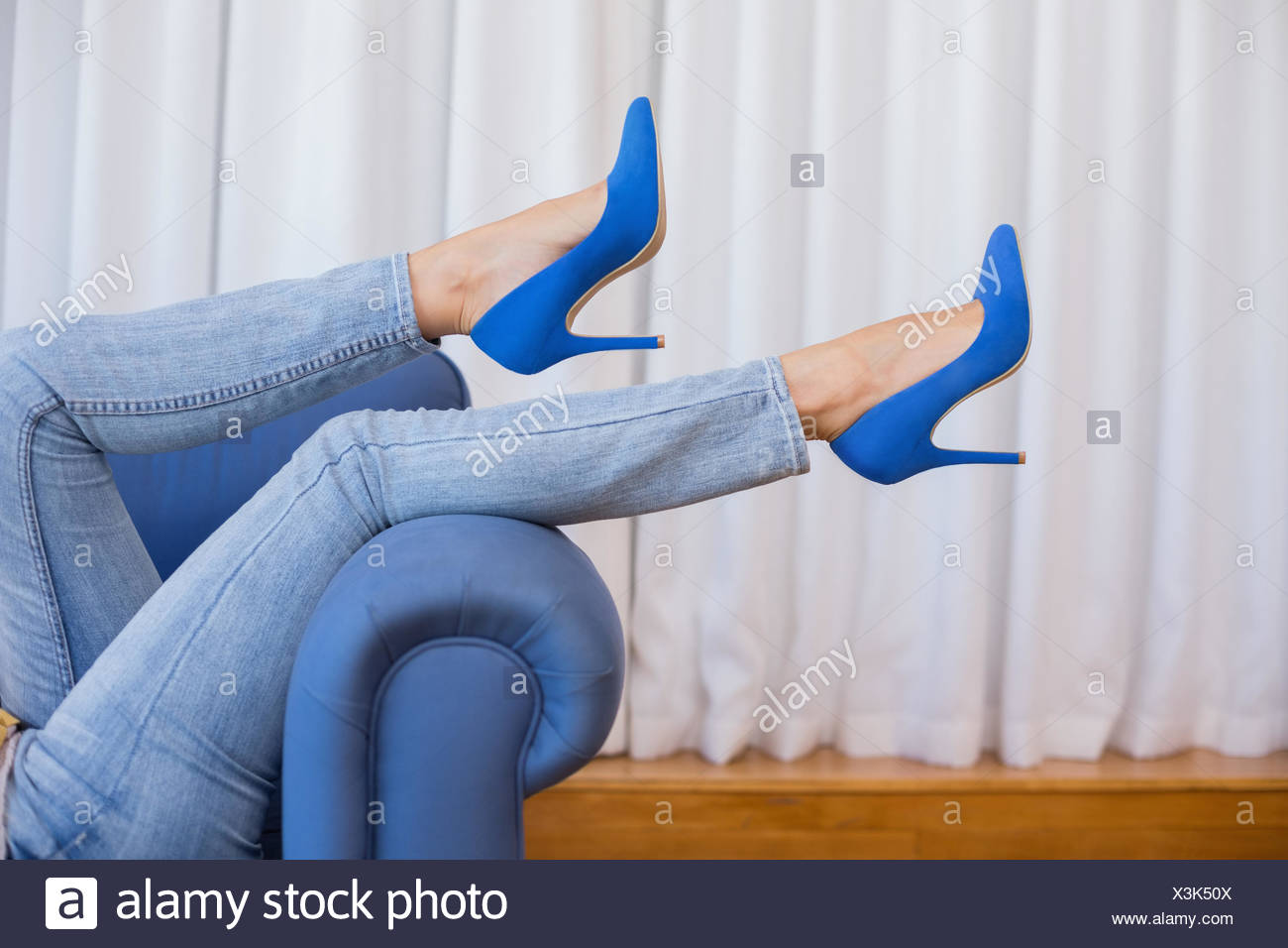 Womans legs in high heels - Stock Image