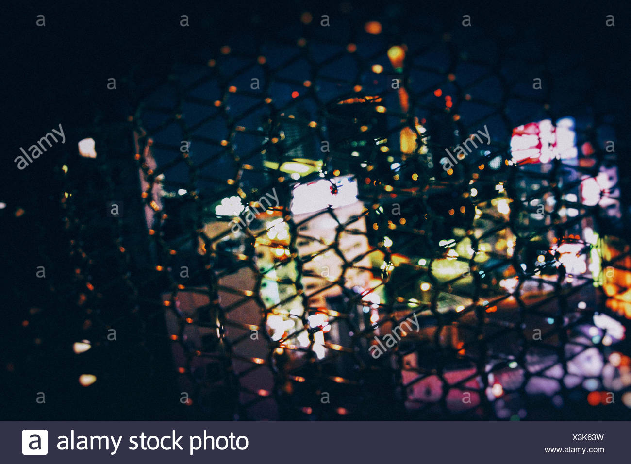 Close-Up Of Fence Against Blurred Background - Stock Image