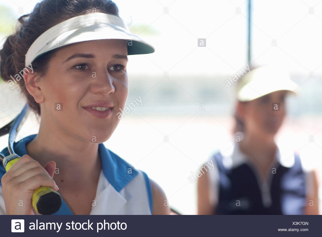 Tennis players observing - Stock Image