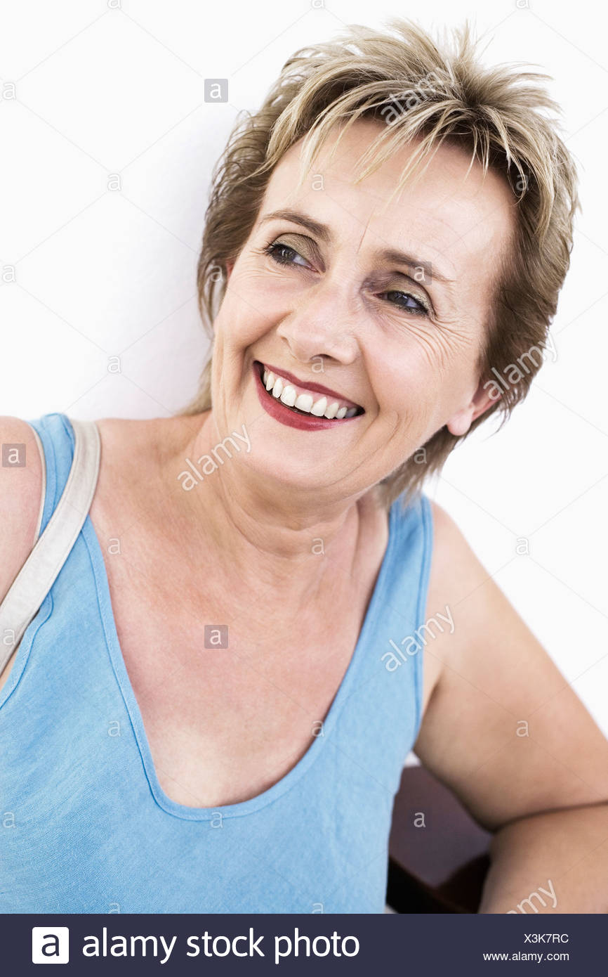 Close-up of a mature woman smiling - Stock Image