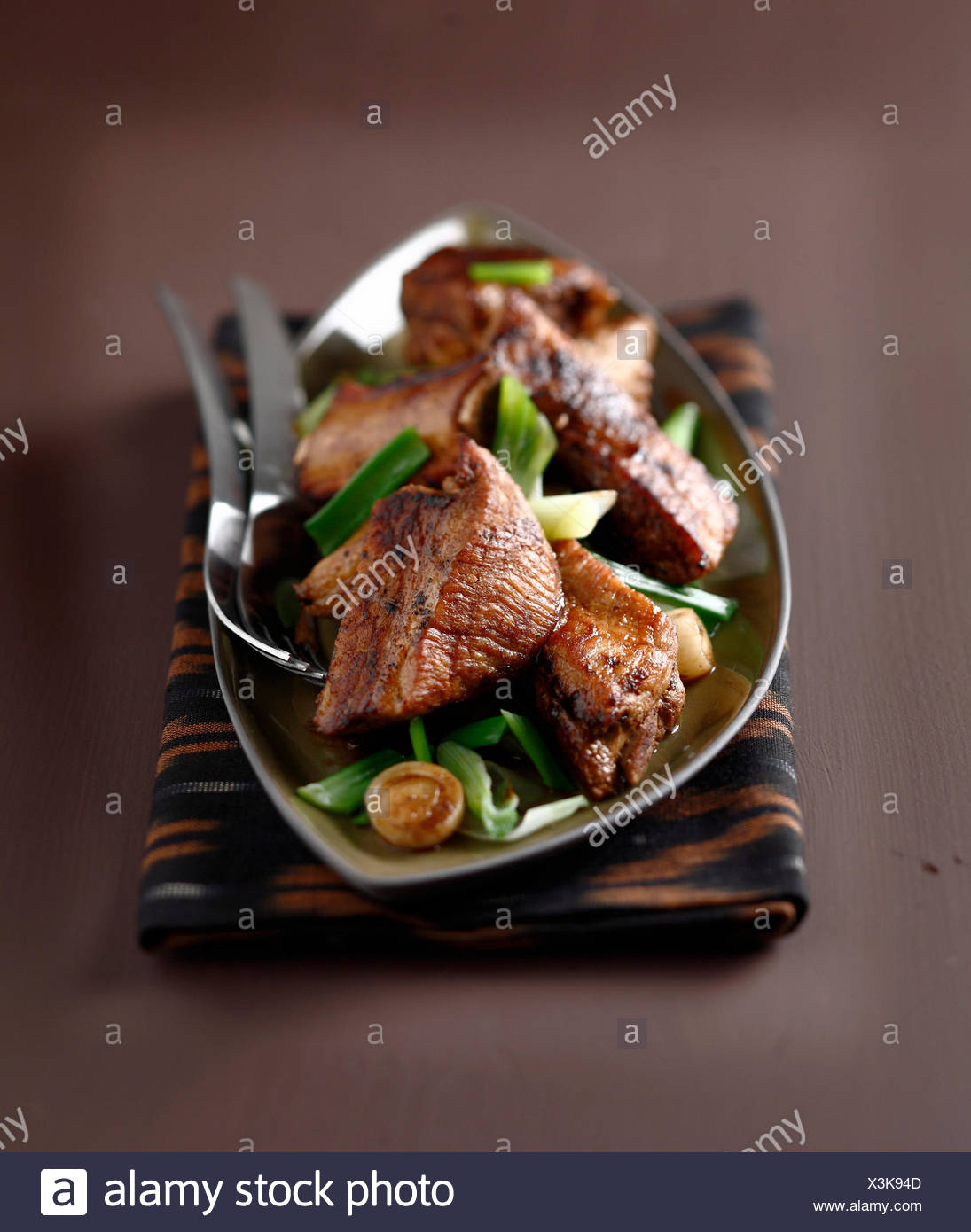 Spare ribs with spring onions - Stock Image