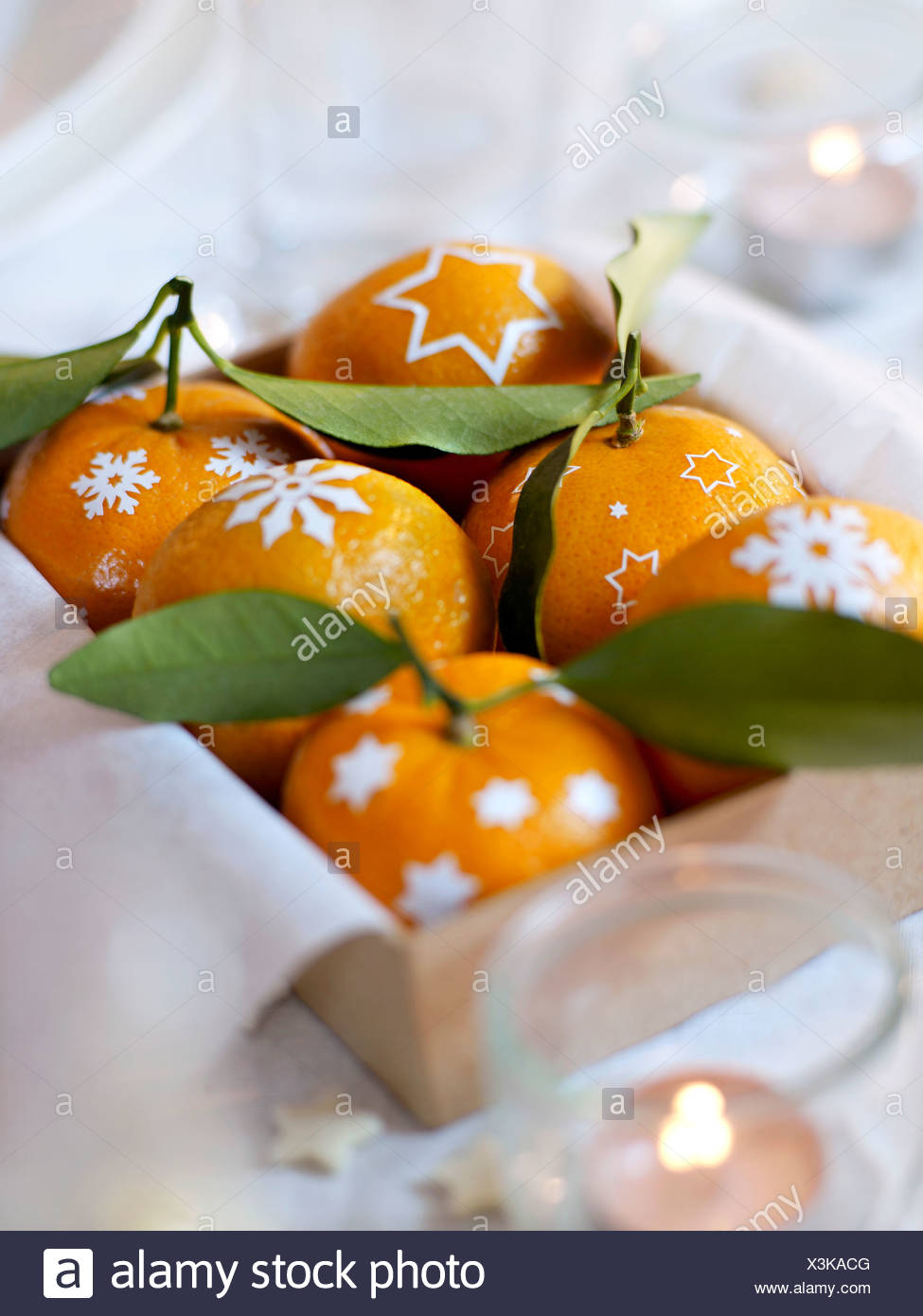 Box of decorated clementines - Stock Image