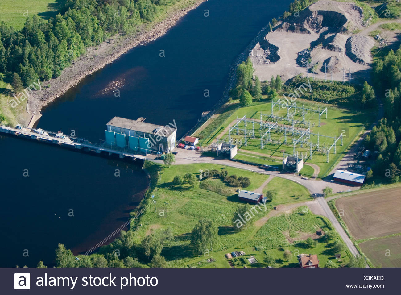 A power station by a river, Sweden. - Stock Image