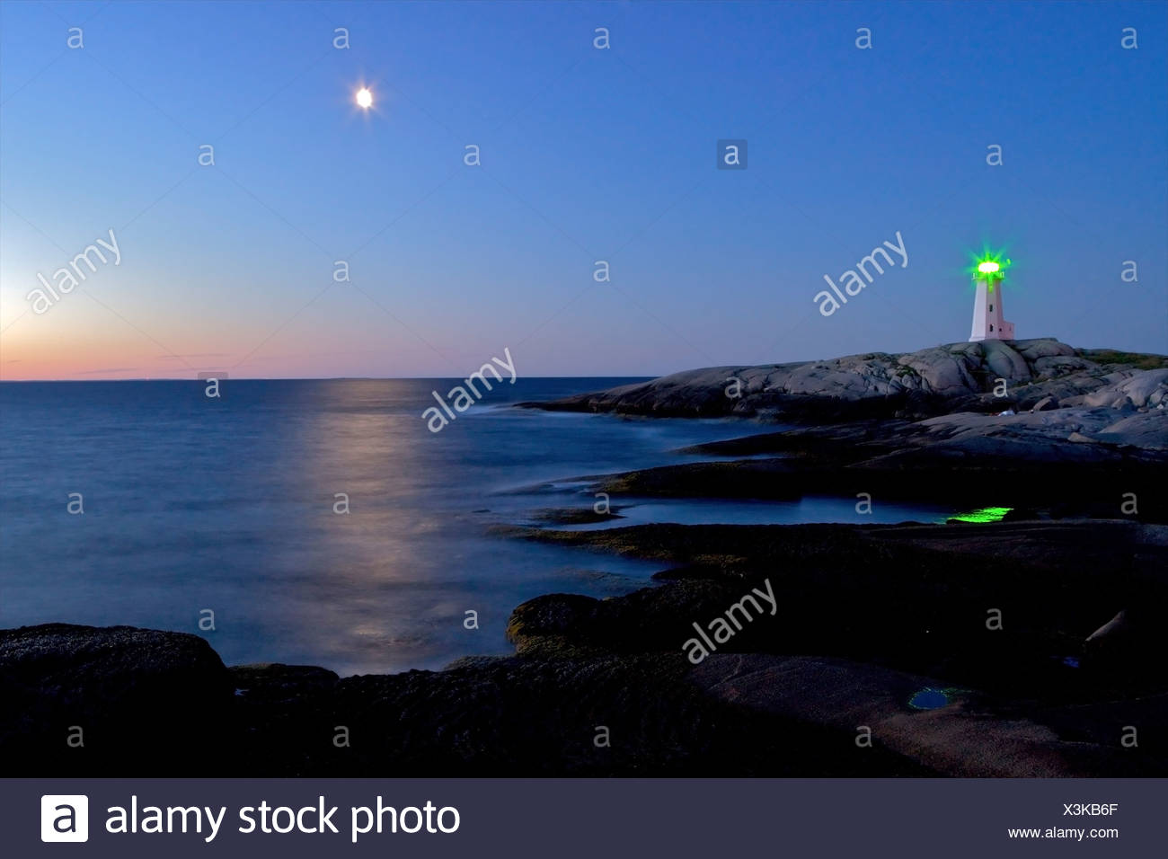 Peggy's Cove Ligthhouse and moon during blue hour, Peggy's Cove, St Margarets Bay, Lighthouse Route, Highway 333, Nova Scotia, C - Stock Image