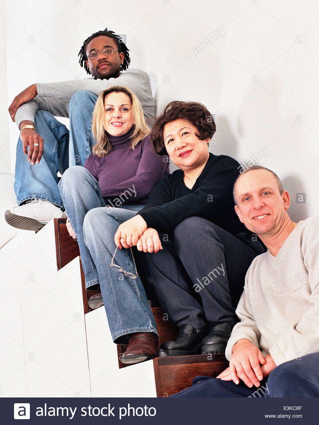 Multiracial people on stairs - Stock Image