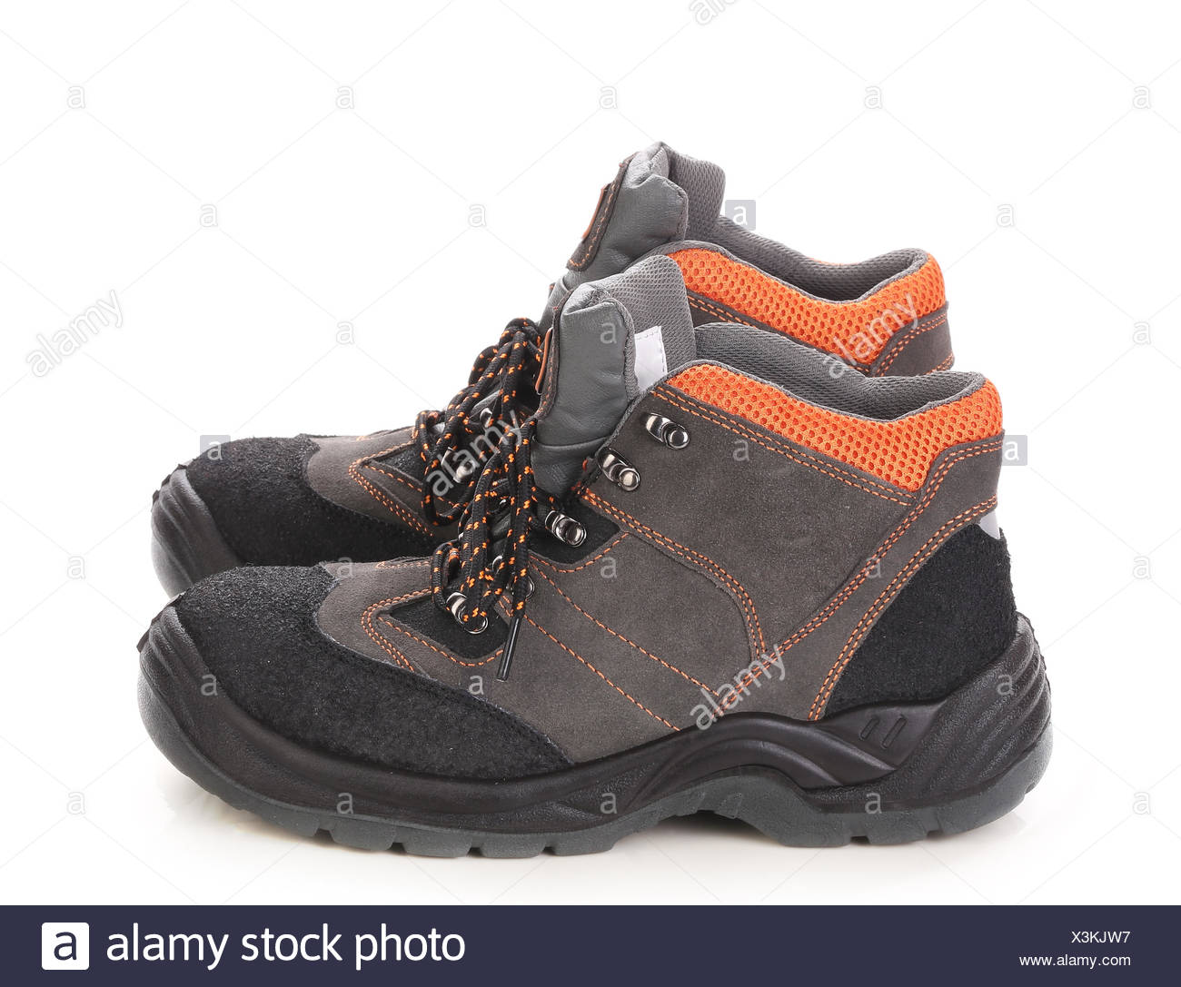 Pair of black and orange men boots Stock Photo: 277641763