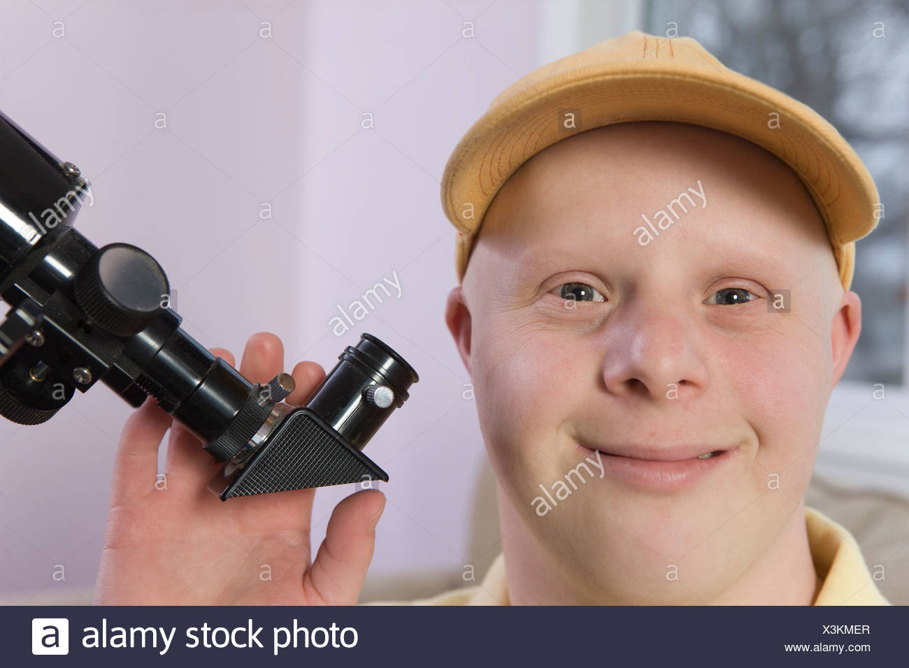 Man with a telescope - Stock Image