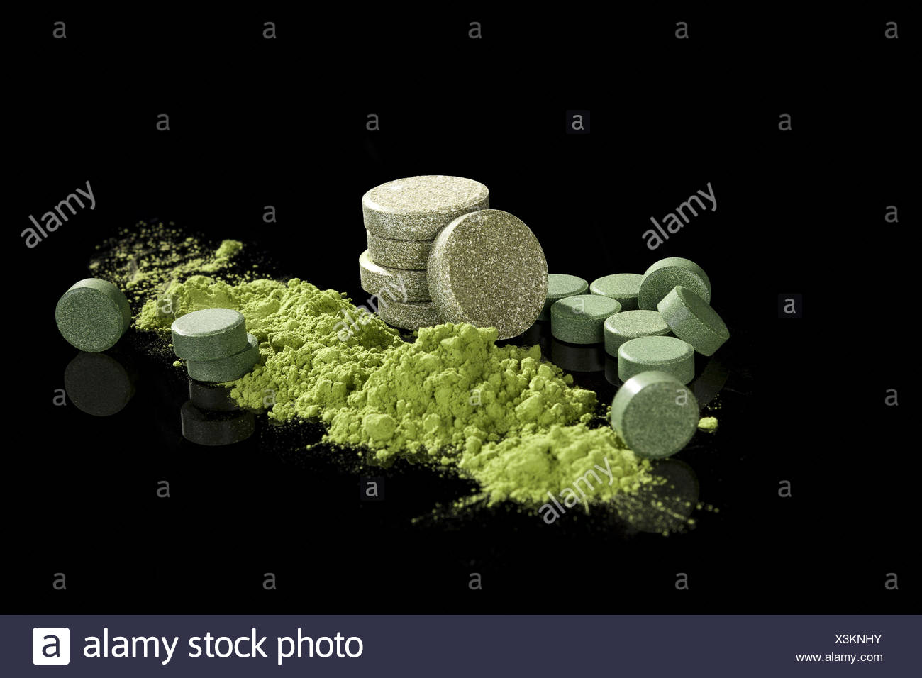 Green dietary supplements. - Stock Image