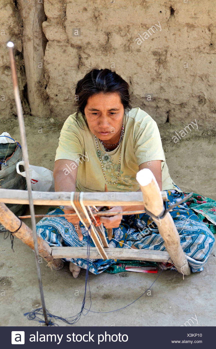 Traditional arts and crafts, woman weaving a ribbon from fibers of chaguar plants, indigenous community of Santa Maria - Stock Image