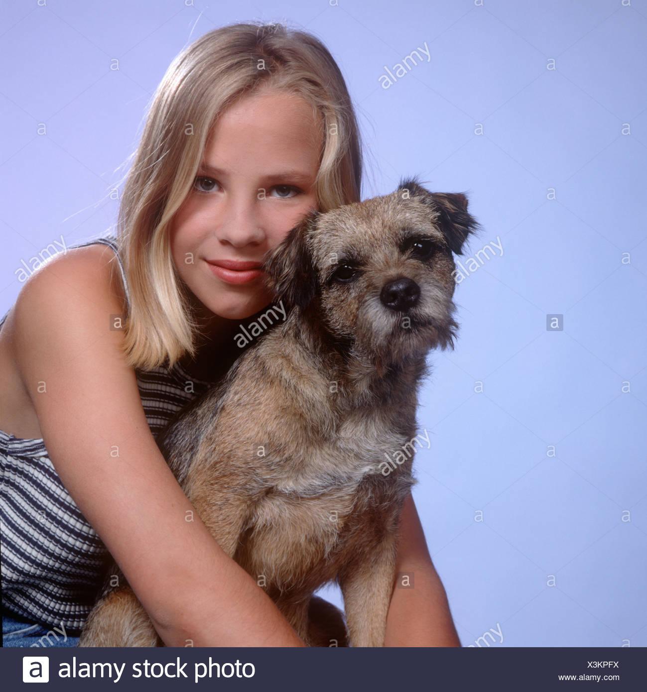 Teen girl and dog - Stock Image