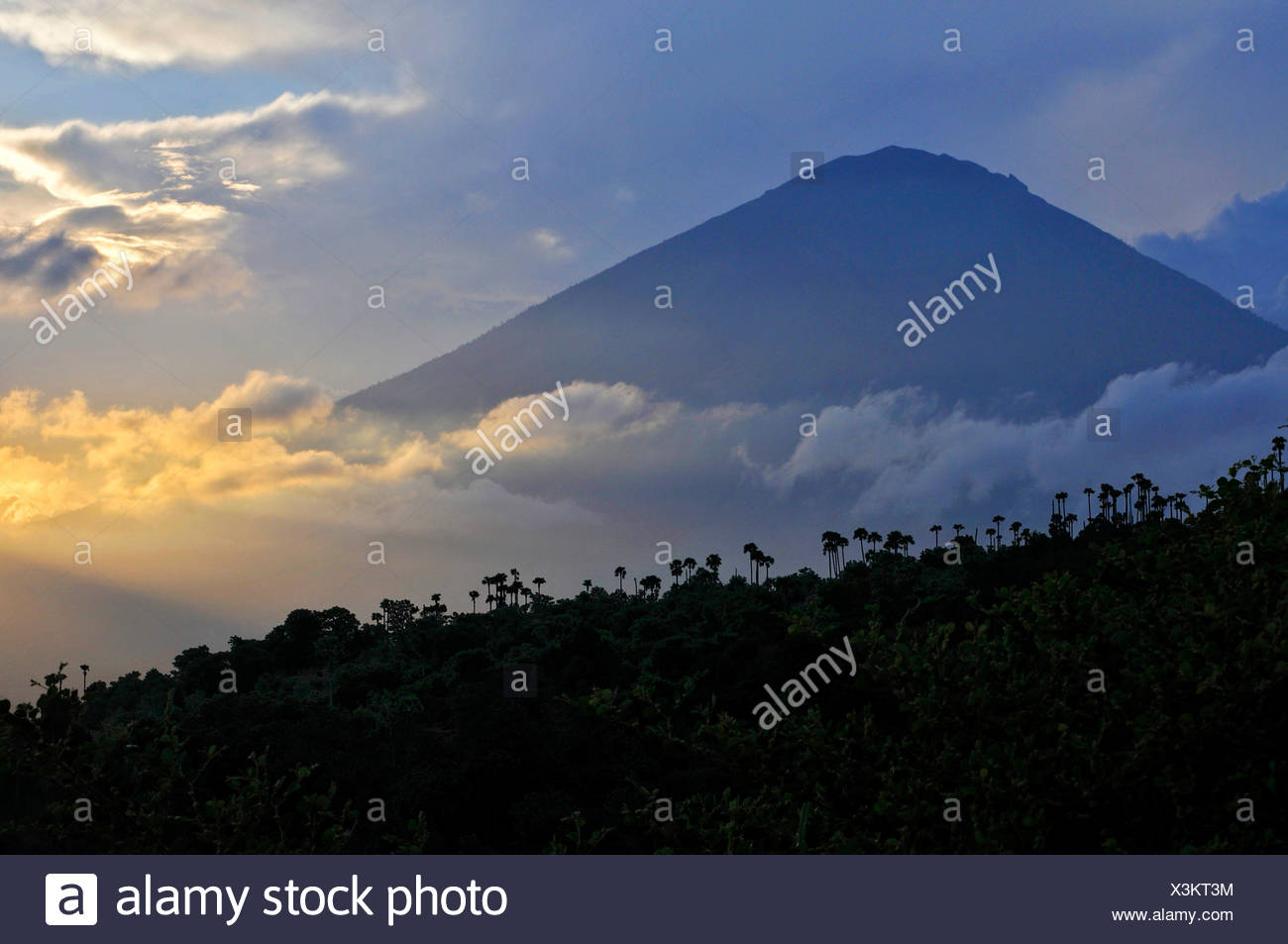 Sunset with the volcano Gunung Agung in Amed, Bali, Indonesia, Southeast Asia - Stock Image