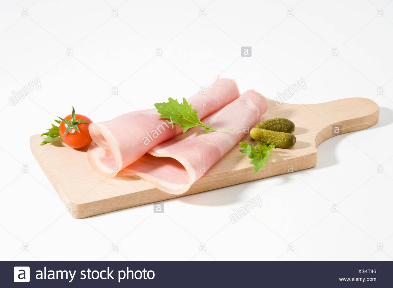 Rolled slices of ham - Stock Image