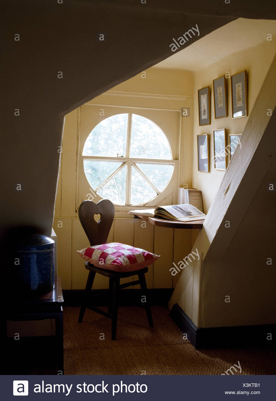 Circular Window In Study Corner Of Attic Bedroom With Patchwork