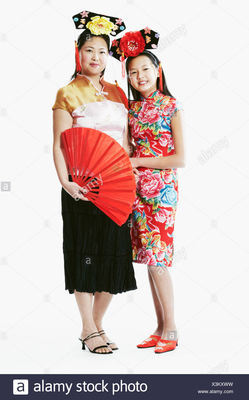 Portrait of a mother and her daughter smiling - Stock Image