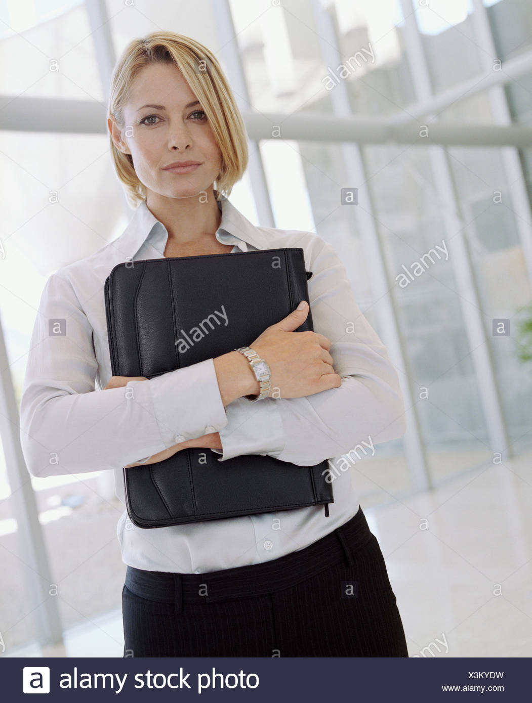 Businesswoman holding attache case - Stock Image