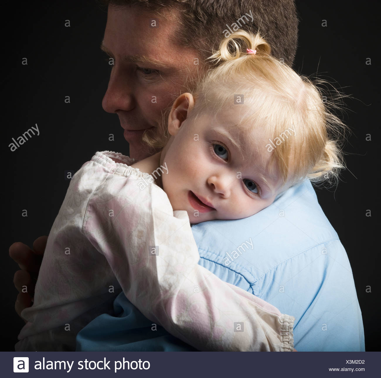 Daughter hugging father Stock Photo