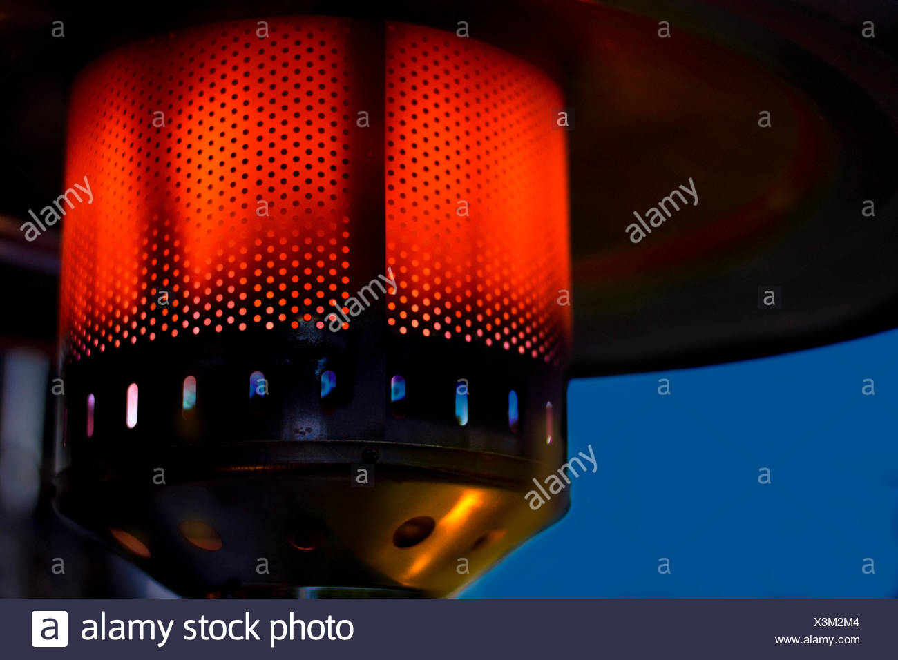 Gas patio heater, at red heat, Germany - Stock Image