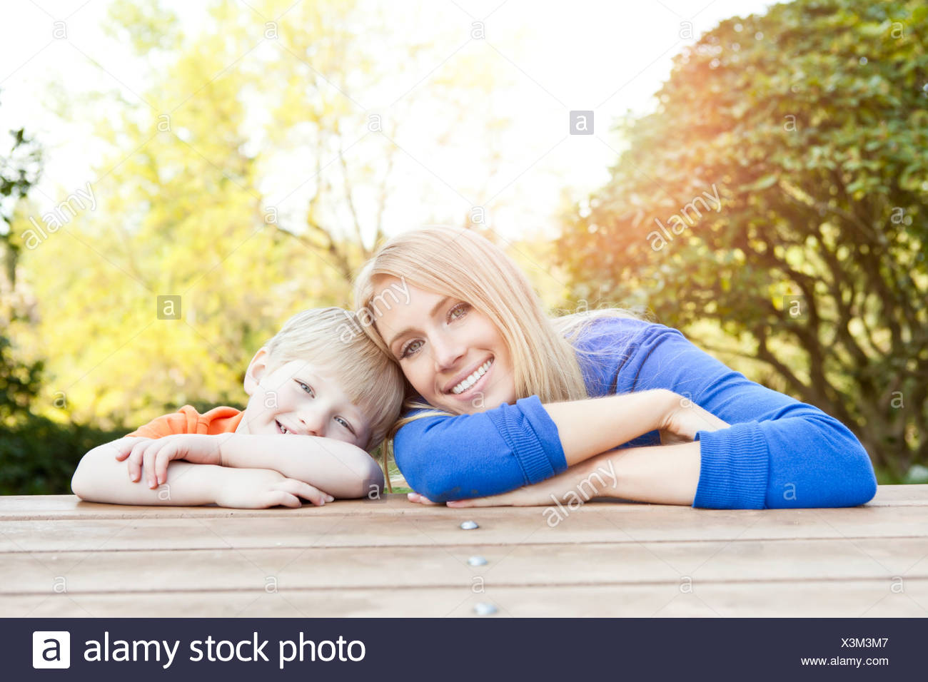 USA, Washington State, Seattle, portrait of mother and son leaning at picnic table - Stock Image