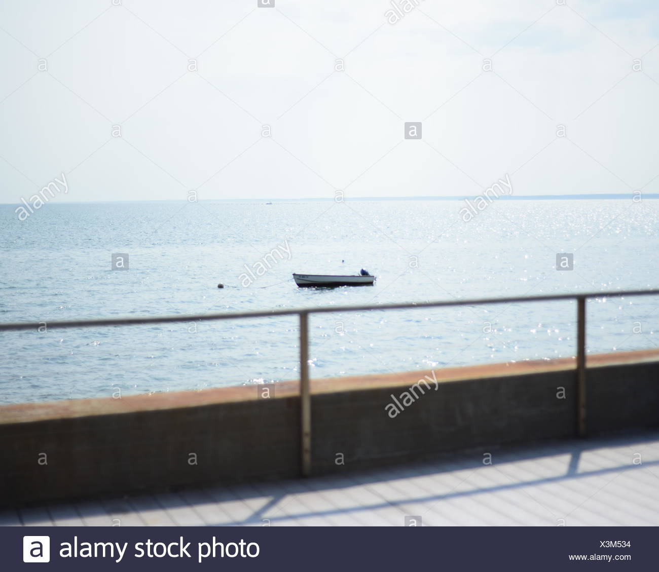 Motorboat Anchored On Sea Against Sky - Stock Image