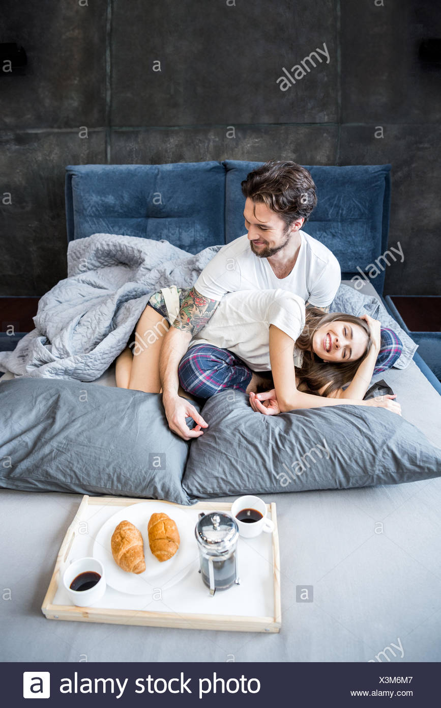 Couple has breakfast in bed - Stock Image