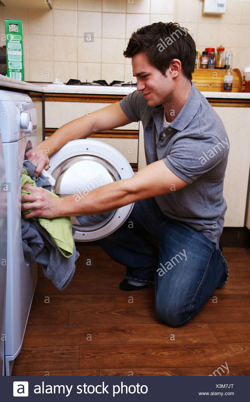 Young man doing the washing - Stock Image