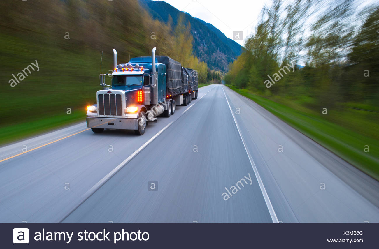 Transport truck on the road south of Hope. - Stock Image
