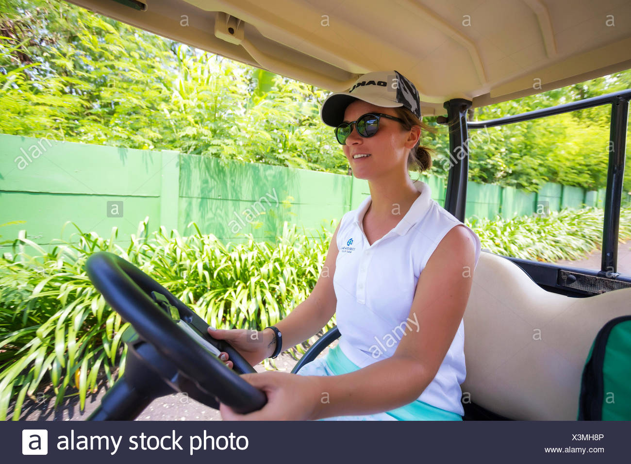 Young woman sitting in golf cart,Bali,Indonesia - Stock Image