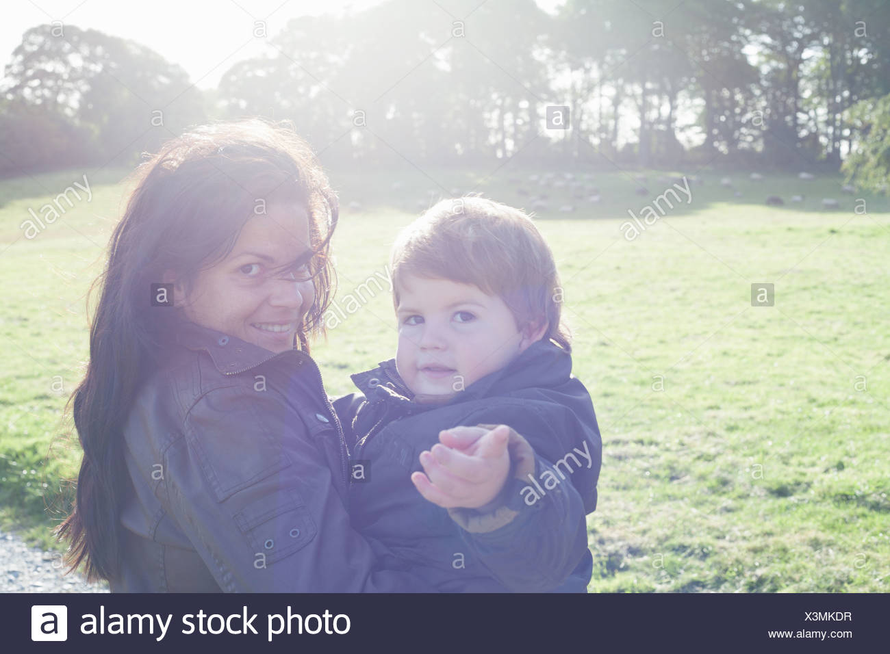 Mother holding son outdoors - Stock Image