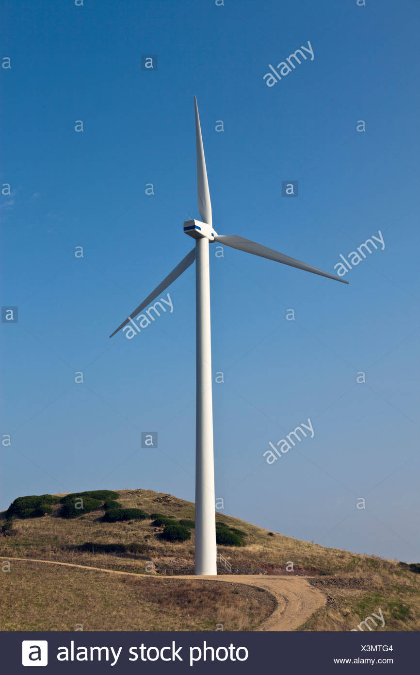Windmill on rural dirt path - Stock Image