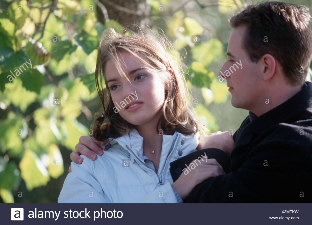 Young man comforting angry girlfriend SerieCVS100024117 - Stock Image